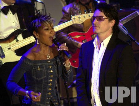 BONO AND MARY J BLIGE PERFORM AT ROCK AND ROLL HALL OF FAME CEREMONIES