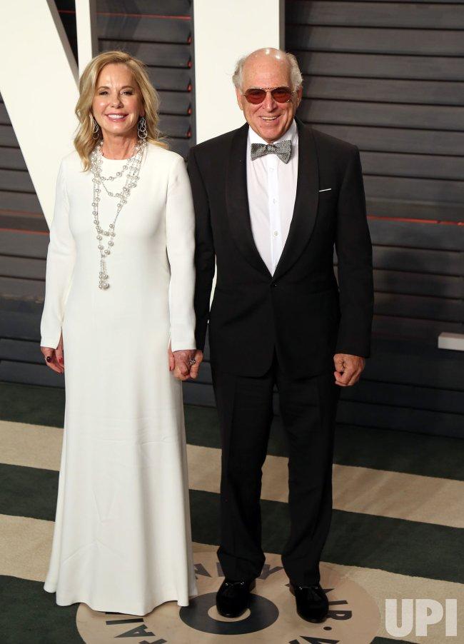 Jimmy Buffett and Jane Buffett arrive at the Vanity Fair Oscar Party