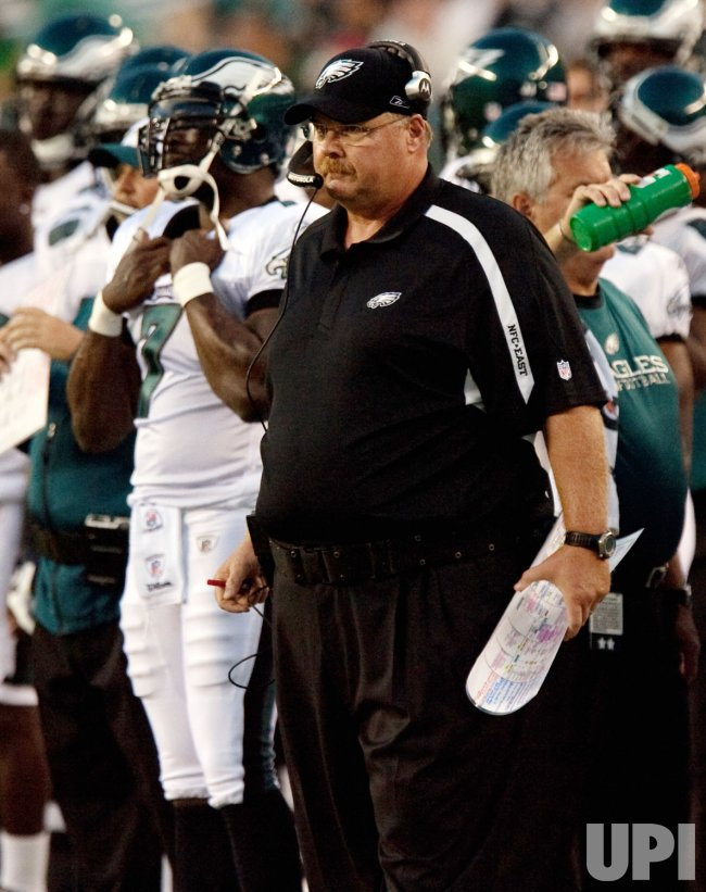 Michael Vick watches game with coach Andy Reid
