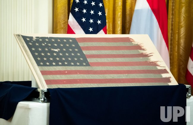 President Trump recieves a WWII Era American Flag from Dutch PM Rutte at the White House