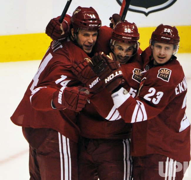 Pyatt, Vermette, and Ekman-Larsson celebrate a goal in Arizona