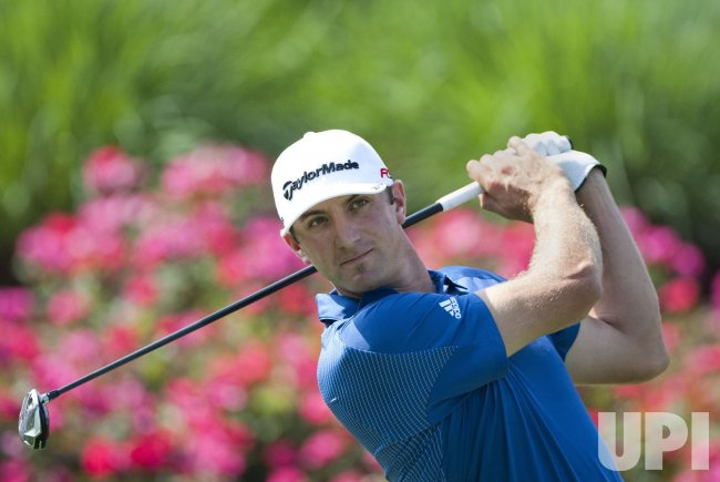 Dustin Johnson tees off at The Players Championship PGA tournament in Florida