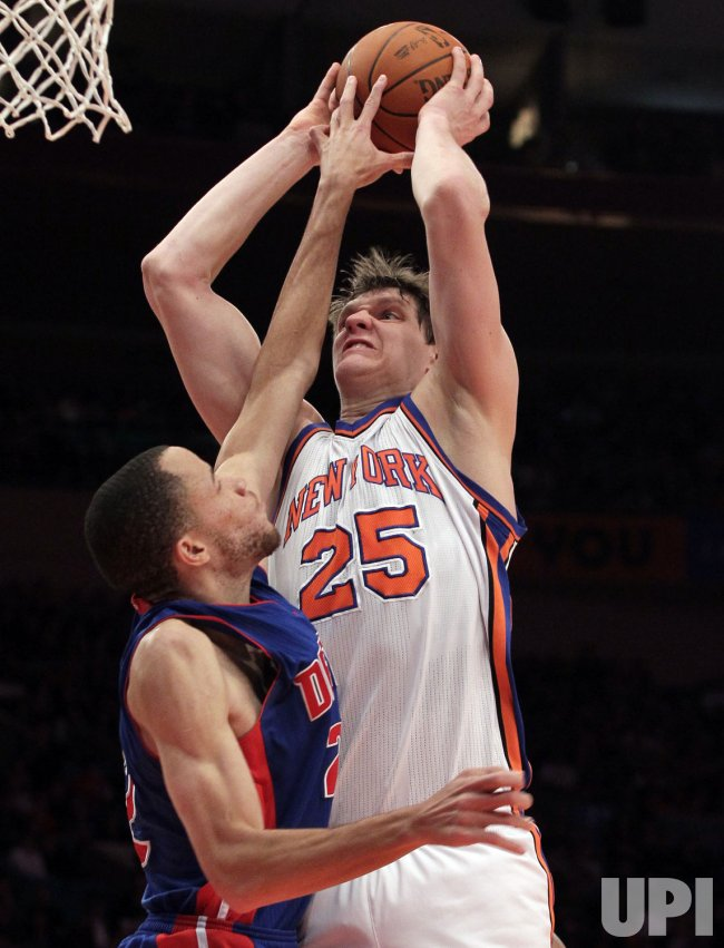 Detroit Pistons Tayshaun Prince tries to block the the shot from New York Knicks Timofey Mozgov at Madison Square Garden in New York