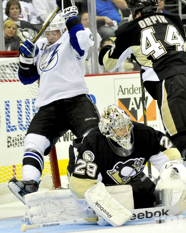 Penguins Orpik Checks Tampa Bay's Bergenheim into Goal in Pittsburgh