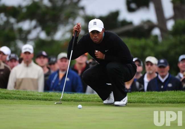 Tiger Woods lines up a putt at the U.S. Open in Pebble Beach, California