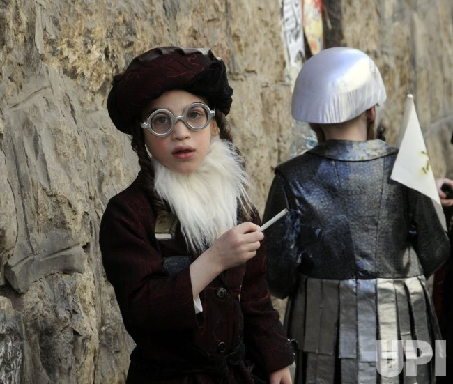 An Ultra-Orthodox boy smokes a cigarette on Purim in Jerusalem
