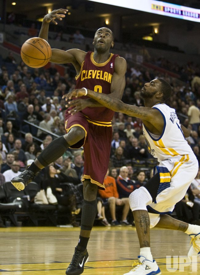 Cavaliers Christian Eyenga has the ball knocked away by Warriors Dorell Wright in Oakland, California