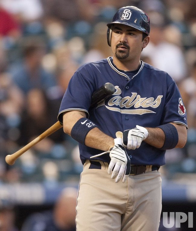 Padres Gonzalez Adjusts His Batting Glove in Denver