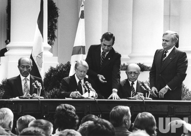 Anwar Sadat, Jimmy Carter and Menachem Begin during the Peace Treaty signing