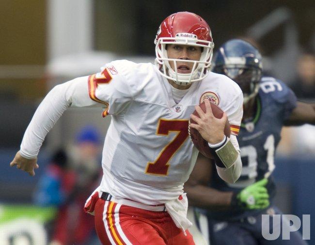 pretty nice 19f42 bbeac Kansas City Chiefs quarter back Matt Cassel scrambles away ...