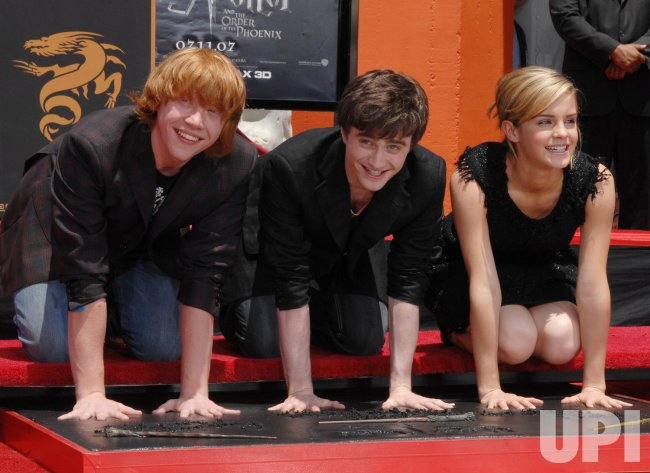 "STARS OF ""HARRY POTTER"" FILMS PLACE HAND AND FOOTPRINTS IN CEMENT AT GRAUMAN'S DURING CEREMONY IN LOS ANGELES"