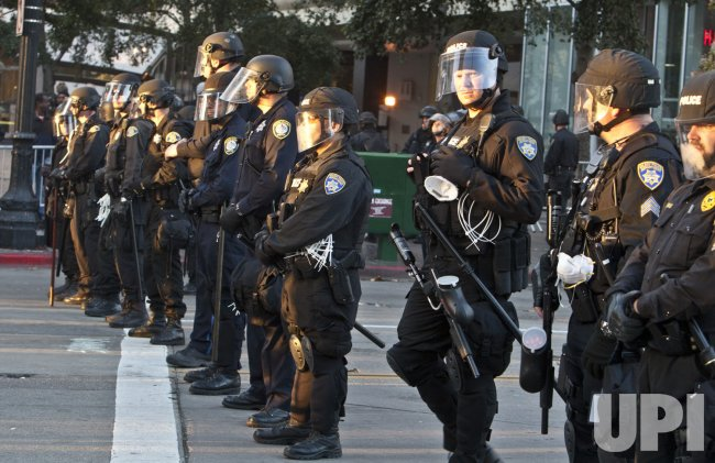 Police raid Occupy Oakland encampment in Oakland, California