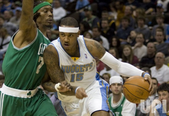 Nuggets Anthony Drives Against Celtics Daniels in Denver