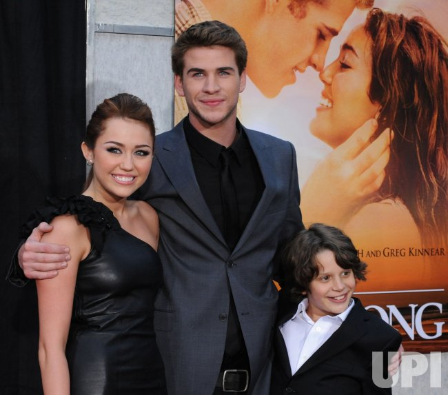 "Miley Cyrus, Liam Hemsworth and Bobby Coleman attend the ""The Last Song"" premiere in Los Angeles"