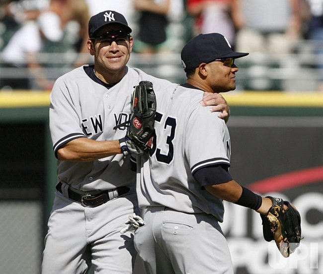New York Yankees' Johnny Damon and Melky Cabrera celebrate their win over the Chicago White Sox