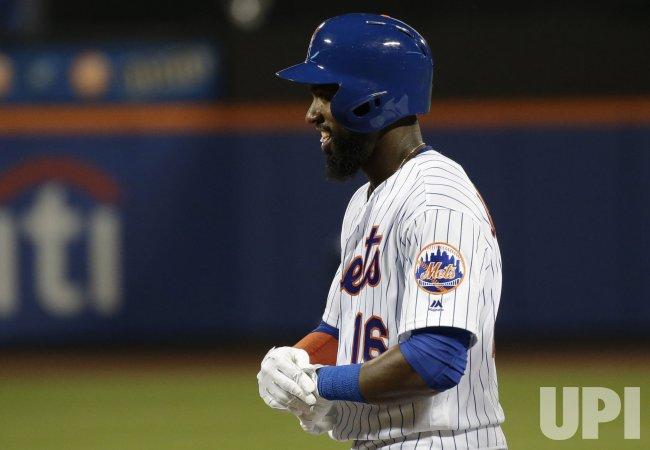 New York Mets Austin Jackson smiles standing on first base