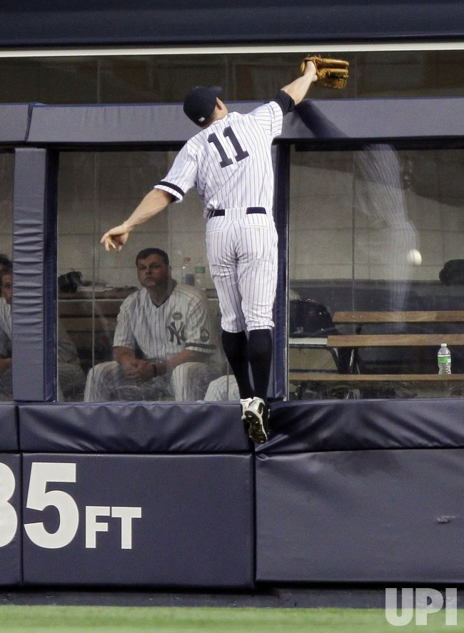 New York Yankees Brett Gardner leaps at Yankee Stadium in New York