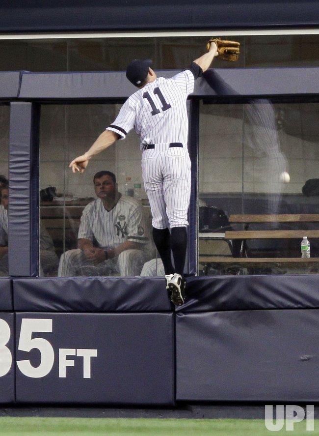 New York Yankees Brett Gardner leaps at Yankee Stadium in New York
