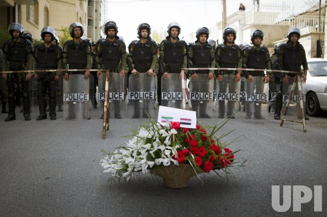Iranian students deliver flowers to Egypt Interests Section in Tehran, Iran.