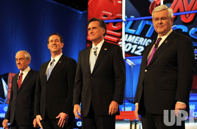 Republican presidential candidates stand before they debate in Arizona