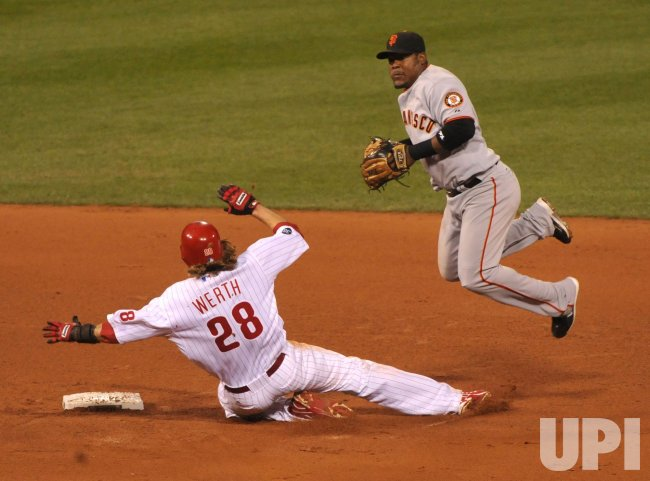 Giants' shortstop Juan Uribe tags out Phillies Jayson Werth during game 1 of the NLCS in Philadelphia