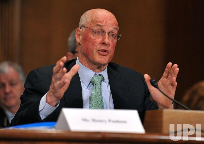 Former Treasury Secretary Henry Paulson testifies on investment banking in Washington