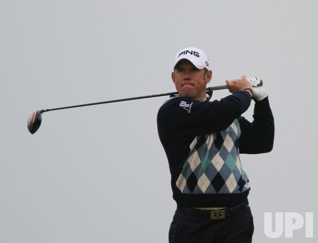Lee Westwood tees off on the 12th hole during the Open Championship in England.