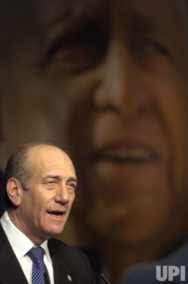 ACTING PRIME MINISTER EHUD OLMERT SPEAKS AT THE OPENING RALLY OF THE KADIMA PARTY IN JERUSALEM
