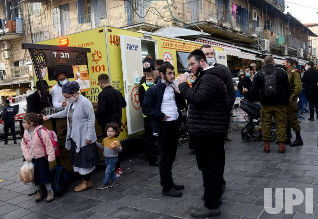 People Stand Outside A Mobile Clinic For The Pfizer-Biotech Coronavirus Vaccine In Jerusalem