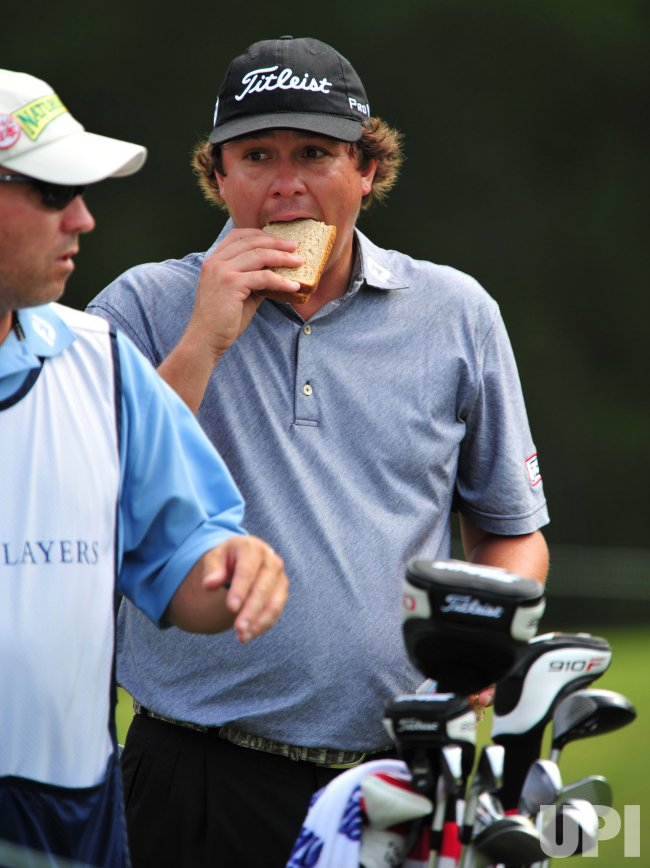 Jason Dufner snacks on sandwhiche during the TPC Players in Florida