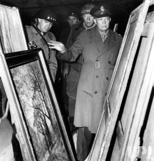 General Omar Bradley, General George Patton and General Dwight Eisenhower inspecting art stolen by the Nazis.