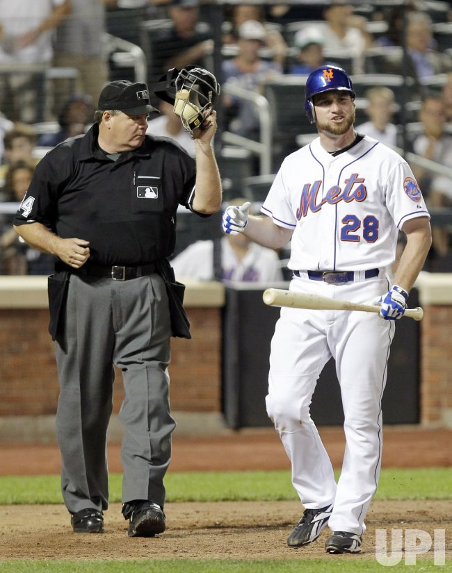 Home plate umpire Jerry Lane watches New York Mets Daniel Murphy react after striking out at Citi Field in New York