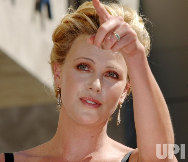 ACTRESS CHARLIZE THERON RECEIVES STAR ON HOLLYWOOD WALK OF FAME