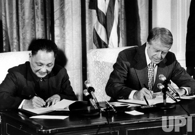 Jimmy Carter and Deng Xiaoping during a signing ceremony at the White House.