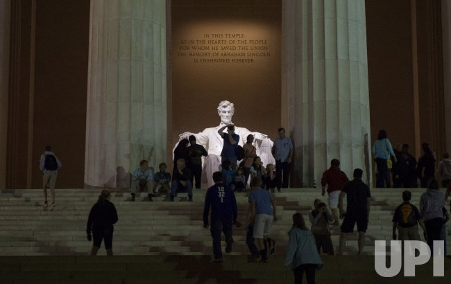 Tourists Visit the Lincoln Memorial as it is Reopened in Washington, D.C.