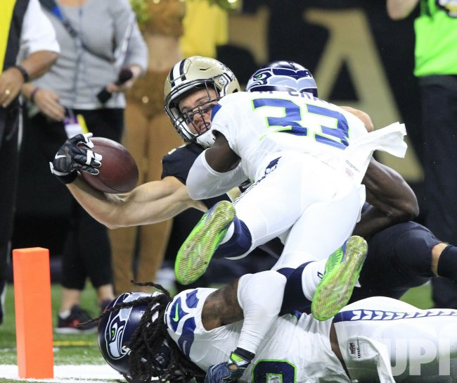 Saints Coby Fleener takes a Drew Brees pass 13 yards against the Seattle