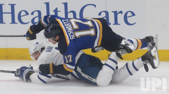 St. Louis Blues Jaden Schwartz falls on Toronto Maple Leafs Ron Hainsey