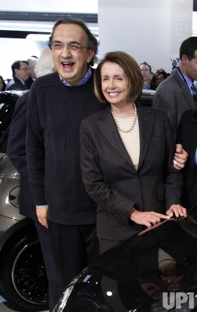speaker pelosi stands with fiat chrysler ceo marchionne in detroit michigan. Black Bedroom Furniture Sets. Home Design Ideas