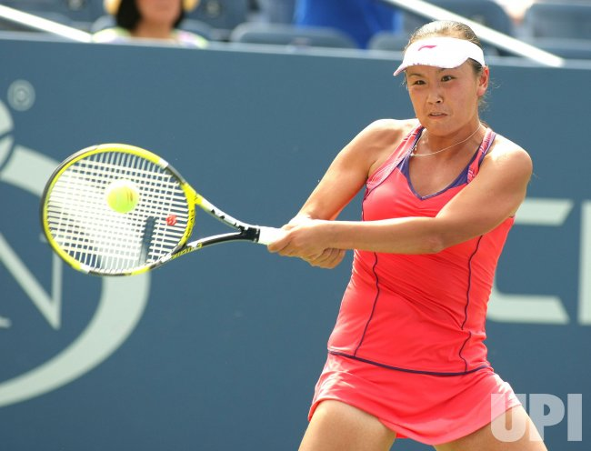 Shuai Peng and Flavia Pennetta compete at the U.S. Open in New York