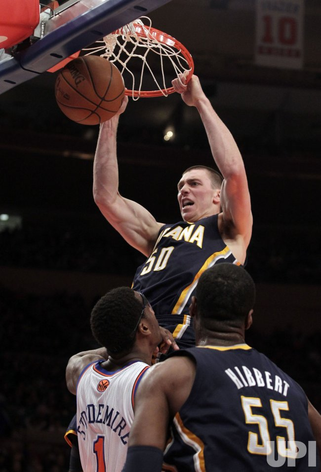 Indiana Pacers Tyler Hansbrough dunks the basketball in front of New York Knicks Amar'e Stoudemire at Madison Square Garden in New York