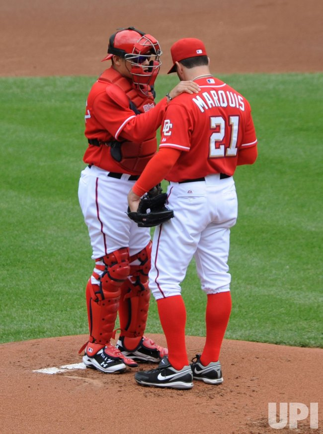 Nationals pitcher Jason Marquis talks to catcher Ivan Rodriquez in Washington