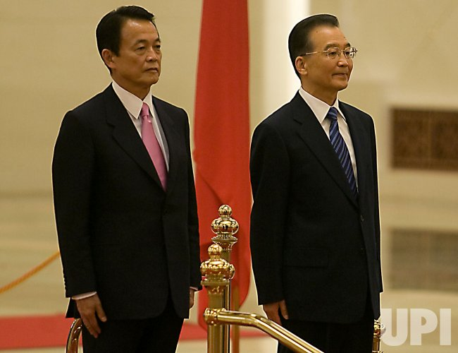 Japan's Prime Minister Aso attends welcoming ceremony in Beijing