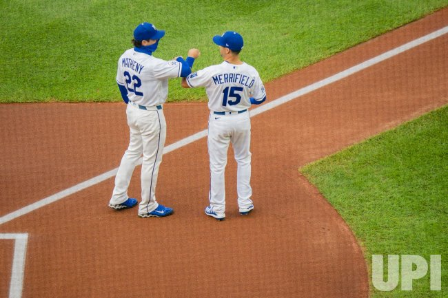 Royals Manager Mike Matheny Arm Bumps Royals Whit Merrifield during Opening Day