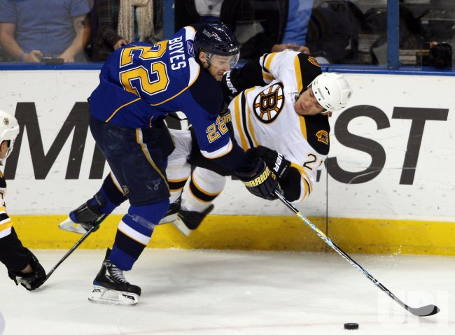 Boston Bruins Andrew Ference and St. Louis Blues Brad Boyes