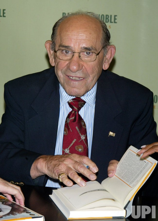 "Yogi Berra signs copies of his new book ""Ten Rings: My Championship Seasons"""