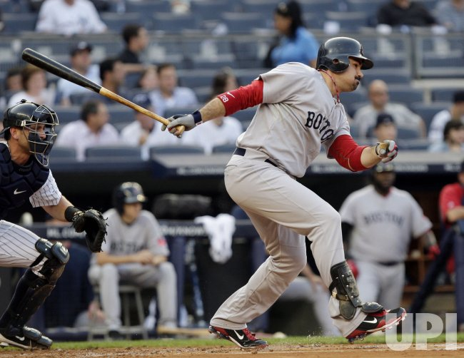 Boston Red Sox Adrian Gonzalez drives in a run at Yankee Stadium in New York