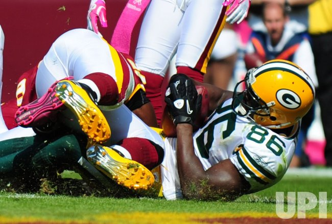 Packers' Donald Lee scores against the Redskins in Maryland