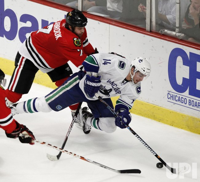 Blackhawks Seabrook checks Canucks Burrows in Chicago