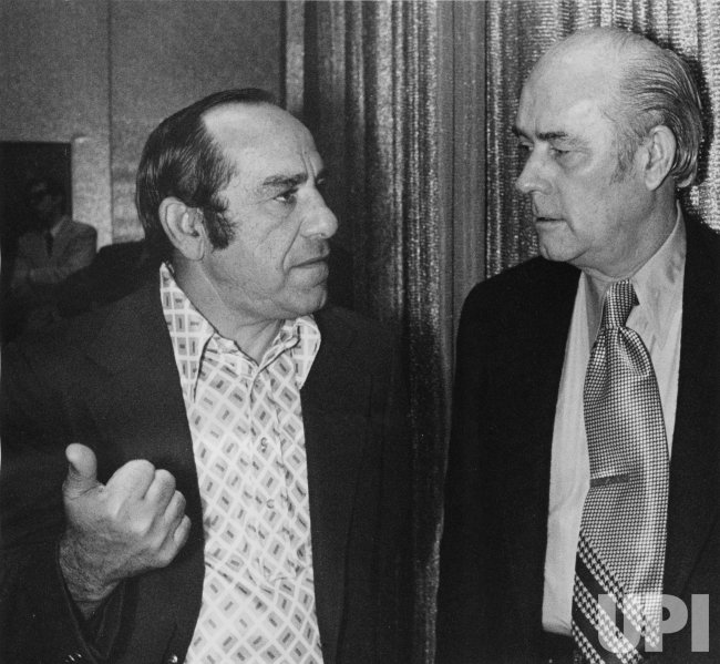 Yogi Berra and Dick O'Connell chat at National Association of Professional Baseball Leagues Convention