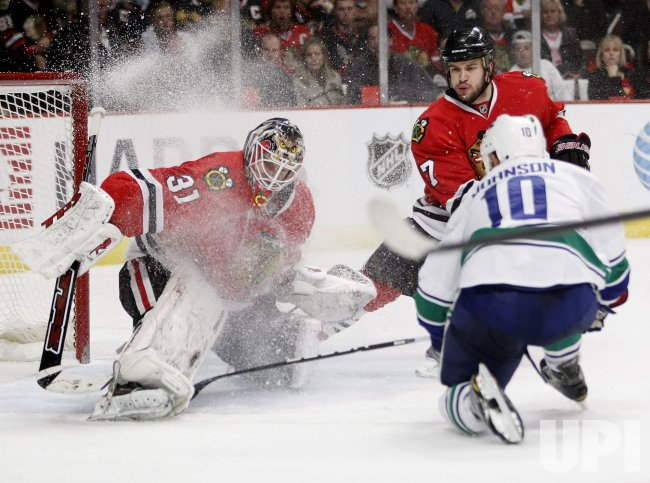 Blackhawks Niemi blocks shot by Canucks Johnson in Chicago